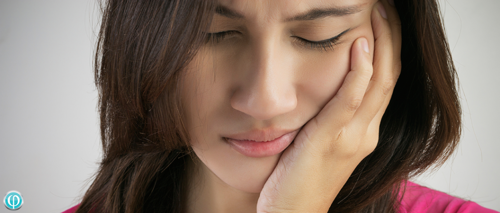 woman with facial pain